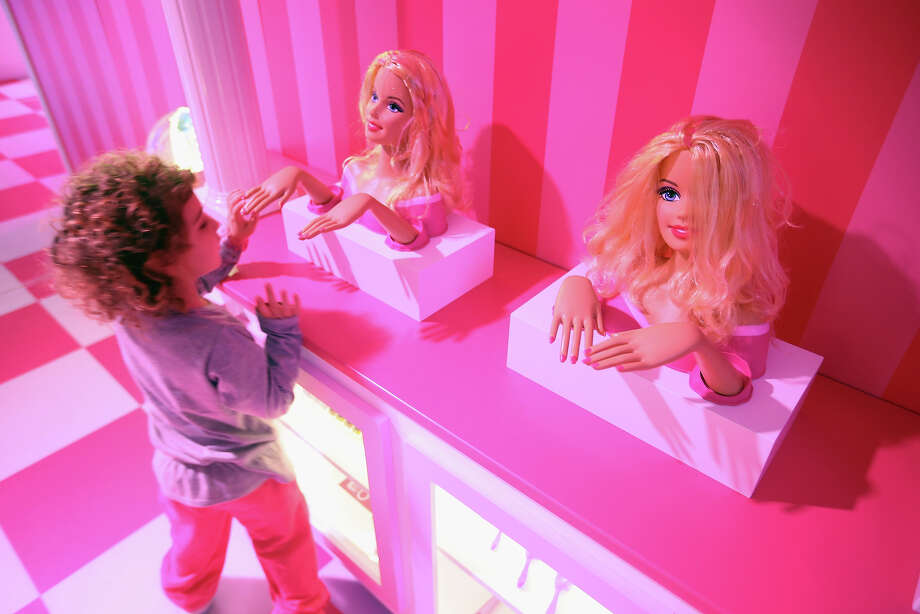 Tamar, 4, who is visiting with her mother from Israel, looks at Barbie busts at the Barbie Dreamhouse Experience on May 16, 2013 in Berlin, Germany. The Barbie Dreamhouse is a life-sized house full of Barbie fashion, furniture and accessories and will be open to the public until August 25 before it moves on to other cities in Europe. Photo: Sean Gallup, Getty Images / 2013 Getty Images