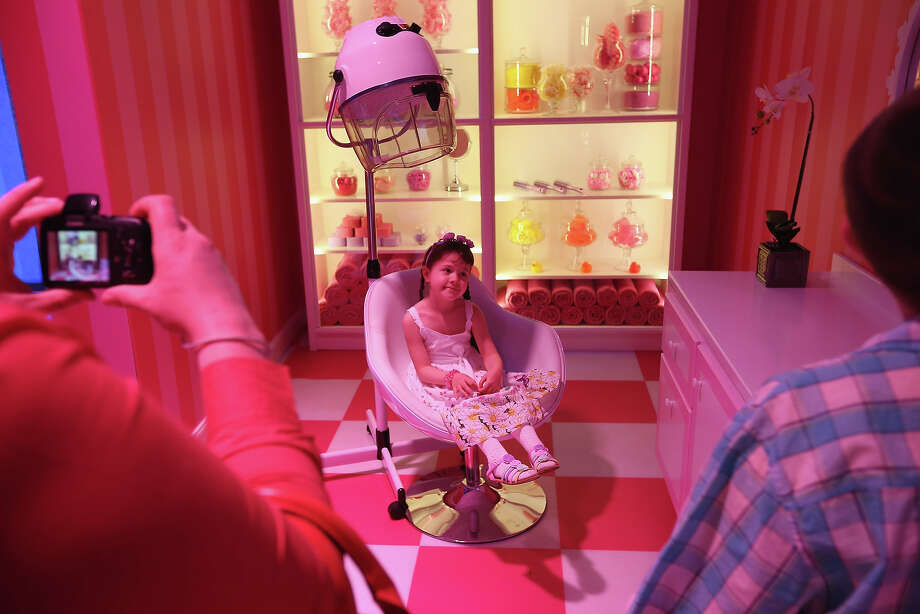Tanja, 6, is photographed by her father while visiting Barbie's bathroom at the Barbie Dreamhouse Experience on May 16, 2013 in Berlin, Germany. The Barbie Dreamhouse is a life-sized house full of Barbie fashion, furniture and accessories and will be open to the public until August 25 before it moves on to other cities in Europe. Photo: Sean Gallup, Getty Images / 2013 Getty Images