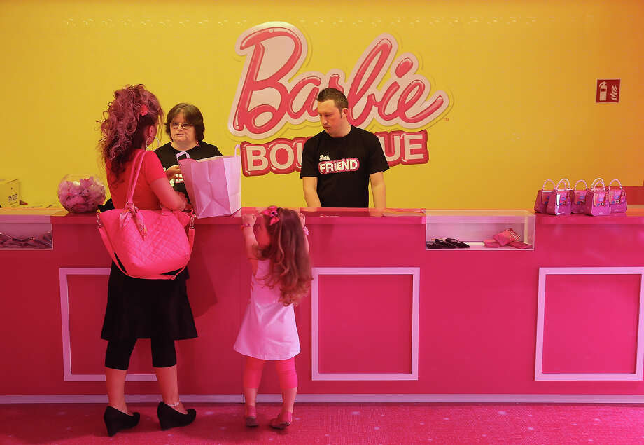 Selina, 3, and her mother Doreen purchase souvenirs at the merchandising shop at the Barbie Dreamhouse Experience with her mother on May 16, 2013 in Berlin, Germany. The Barbie Dreamhouse is a life-sized house full of Barbie fashion, furniture and accessories and will be open to the public until August 25 before it moves on to other cities in Europe. Photo: Sean Gallup, Getty Images / 2013 Getty Images