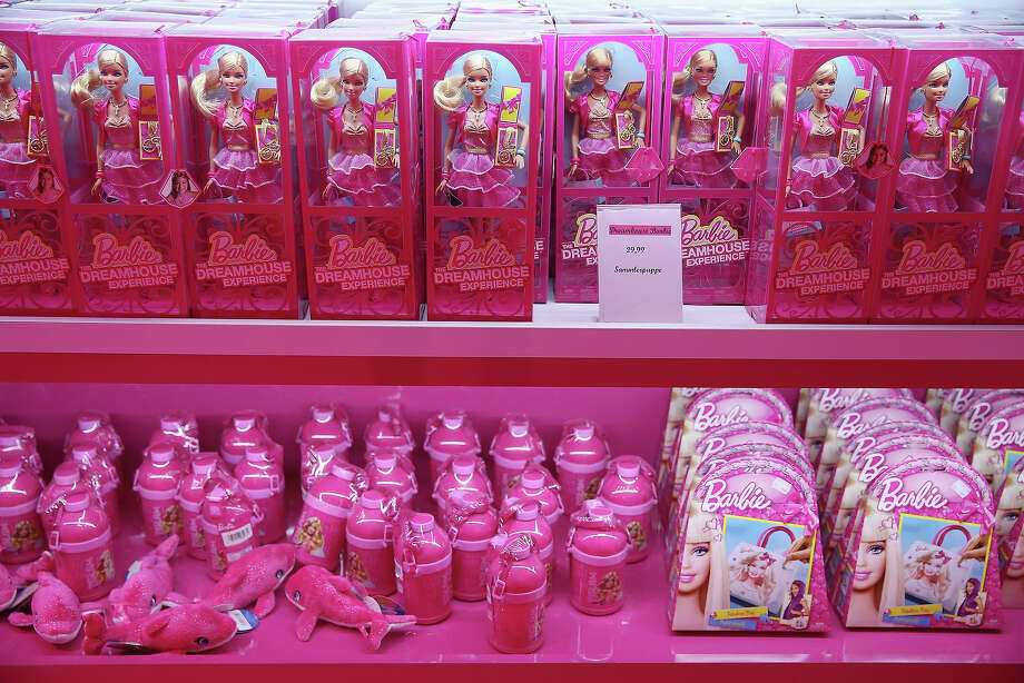 Barbie dolls and other souvenirs line shelves at the merchandising shop at the Barbie Dreamhouse Experience on May 16, 2013 in Berlin, Germany. The Barbie Dreamhouse is a life-sized house full of Barbie fashion, furniture and accessories and will be open to the public until August 25 before it moves on to other cities in Europe. Photo: Sean Gallup, Getty Images / 2013 Getty Images