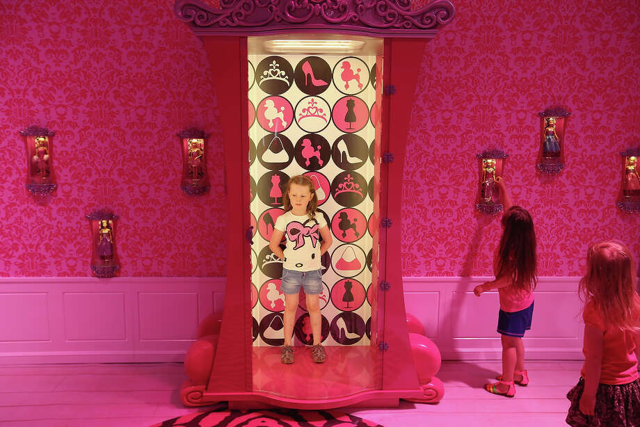 Lara, 6, stands in a special armoire in Barbie's bedroom  while visiting the Barbie Dreamhouse Experience with her friends Josi and Luna on May 16, 2013 in Berlin, Germany. The Barbie Dreamhouse is a life-sized house full of Barbie fashion, furniture and accessories and will be open to the public until August 25 before it moves on to other cities in Europe. Photo: Sean Gallup, Getty Images / 2013 Getty Images