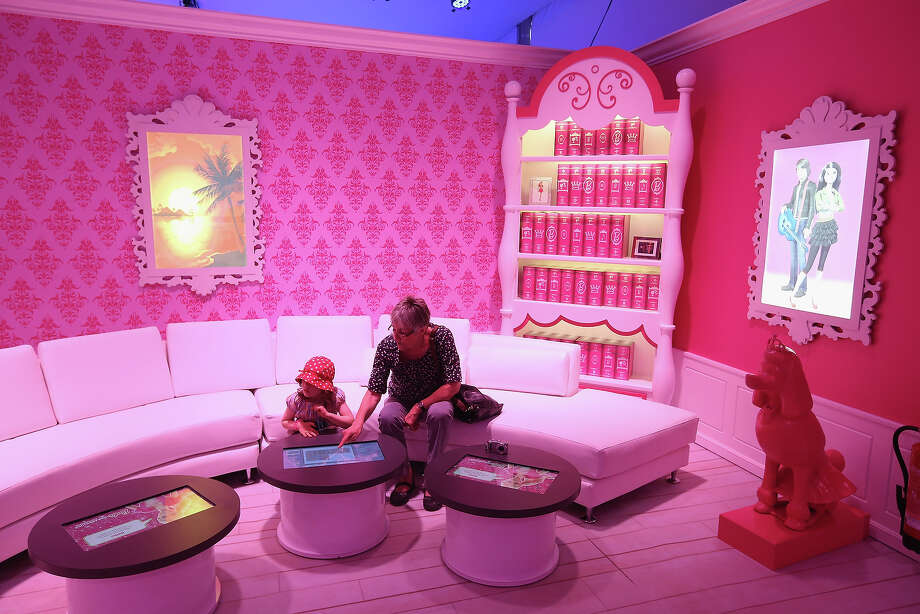 Karlota, 5, and her grandmother visit the Barbie Dreamhouse Experience on May 16, 2013 in Berlin, Germany. The Barbie Dreamhouse is a life-sized house full of Barbie fashion, furniture and accessories and will be open to the public until August 25 before it moves on to other cities in Europe. Photo: Sean Gallup, Getty Images / 2013 Getty Images