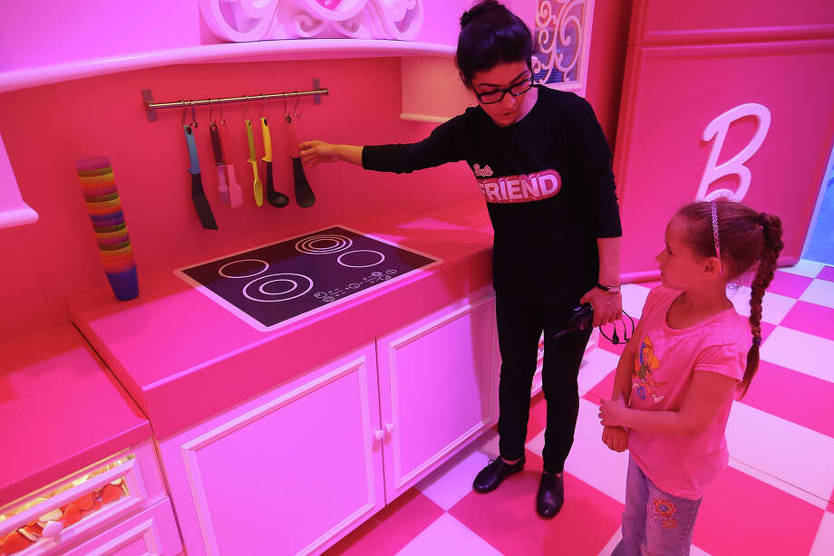 Lina, 7, gets a tour of the kitchen at the Barbie Dreamhouse Experience on May 16, 2013 in Berlin, Germany. The Barbie Dreamhouse is a life-sized house full of Barbie fashion, furniture and accessories and will be open to the public until August 25 before it moves on to other cities in Europe. Photo: Sean Gallup, Getty Images / 2013 Getty Images
