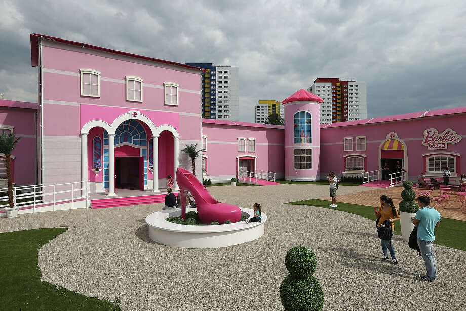 Visitors arrive at the Barbie Dreamhouse Experience on May 16, 2013 in Berlin, Germany. The Barbie Dreamhouse is a life-sized house full of Barbie fashion, furniture and accessories and will be open to the public until August 25 before it moves on to other cities in Europe. Photo: Sean Gallup, Getty Images / 2013 Getty Images
