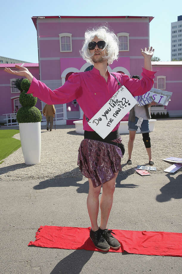 Protesters demonstrating against materialist stereotypes of women pose outside the Barbie Dreamhouse Experience on May 16, 2013 in Berlin, Germany. The Barbie Dreamhouse is a life-sized house full of Barbie fashion, furniture and accessories and will be open to the public until August 25 before it moves on to other cities in Europe. Photo: Sean Gallup, Getty Images / 2013 Getty Images