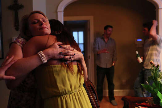 Elle Helmer hugs her best friend, Nicole Colligan, who recently moved to a town two hours away, as Nicole gets ready to go home after the Easter party Elle hosted at her home in Wilmington, NC on March 31, 2013. Photo: Lisa Krantz / San Antonio Express-News