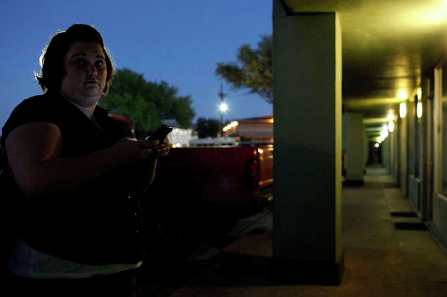 Kelly Smith waits for her husband, Randy Smith, as they head out for dinner from the hotel where they were temporarily living in Abilene on Thursday, Nov. 1, 2012. Photo: Lisa Krantz / San Antonio Express-News