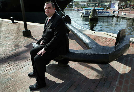 Former Navy sailor Brian Lewis, of Baltimore, who was sexually assaulted while serving his country. Lewis is sitting on the anchor of the USS Constitution in Baltimore. Wednesday, Oct. 17, 2012. Photo: Bob Owen / © 2012 San Antonio Express-News