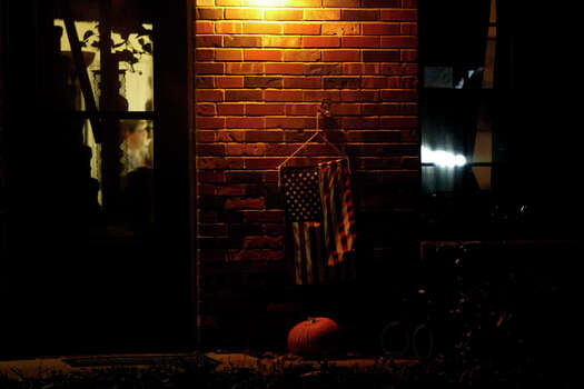 An American flag flies outside the townhouse where Terri Odom lives in St. Louis, MO, on Wednesday, Oct. 24, 2012. Photo: Lisa Krantz / San Antonio Express-News