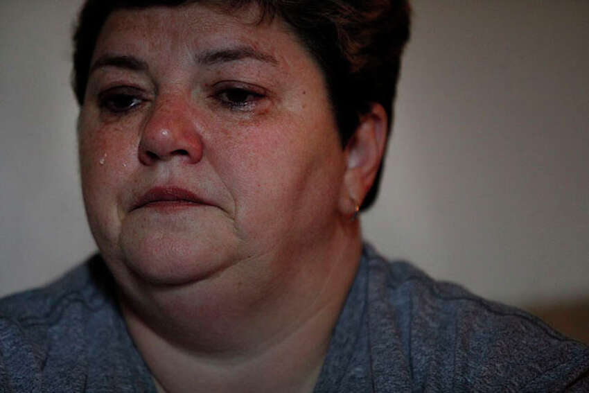 Almost 20 years later, Terri Odom, cries as she recounts the details of how she was brutally attacked and raped when she was stationed in Italy, at her home in St. Louis, MO, on Wednesday, Oct. 24, 2012