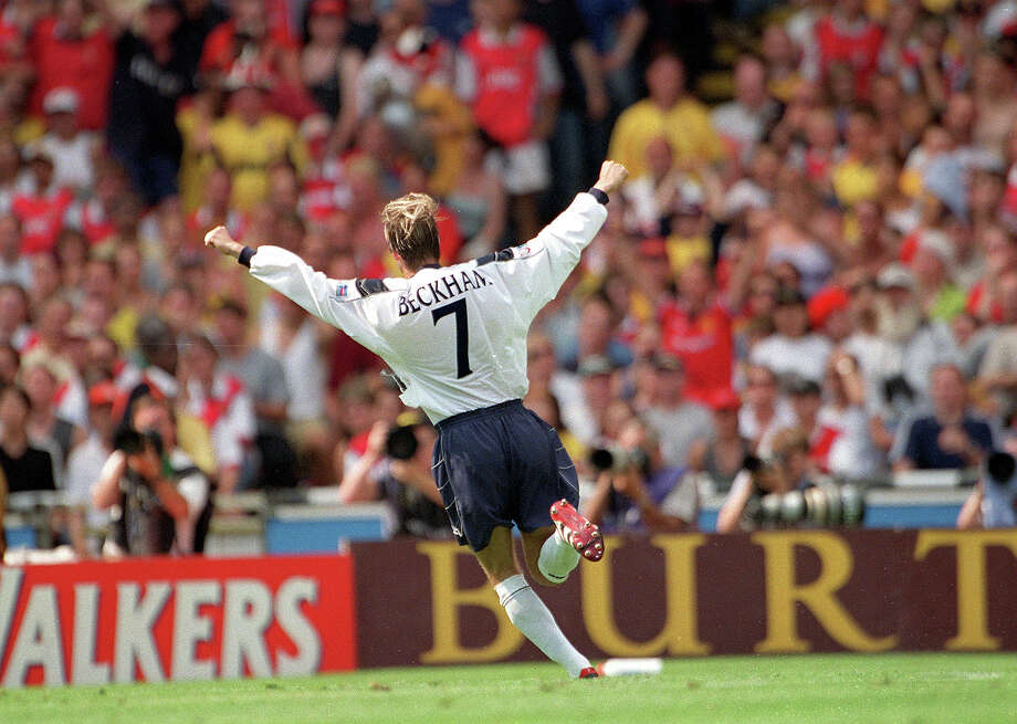 Manchester United's David Beckham celebrates after scoring a first goal from a free kick in 1999. Photo: Popperfoto, Popperfoto/Getty Images / Popperfoto