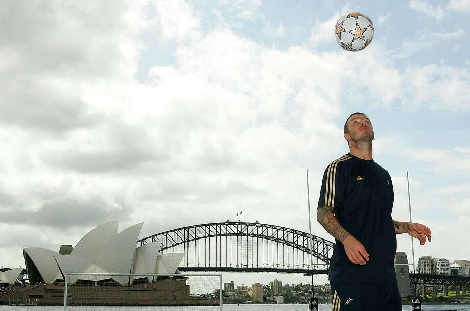 Footballer David Beckham kicks goals with stars from the Australian football codes at Sydney Harbor November 26, 2007 in Sydney. Photo: Matt King, Getty Images / 2007 Getty Images