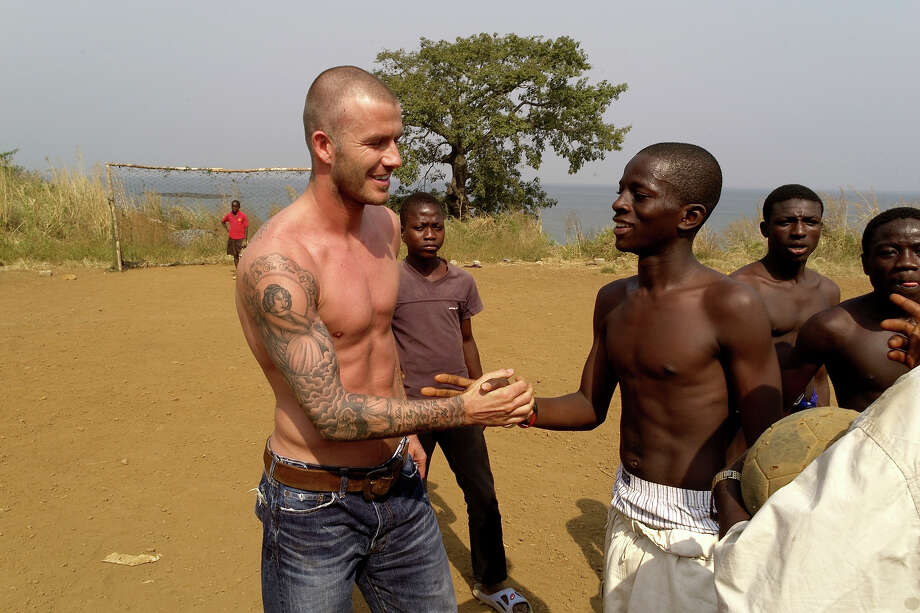 UNICEF Goodwill Ambassador David Beckham (L) participates in a roadside football game on January 19, 2008 in the Aberdeen neighborhood of Freetown, Sierra Leone. Beckham spontaneously joined the match and was instantly recognized by the young players. Photo: David Turnley / 2008 David Turnley