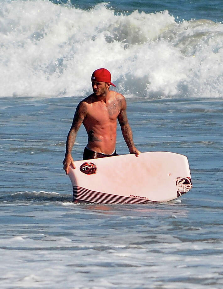 David Beckham plays at a beach in Malibu on August 28, 2011 in Los Angeles. Photo: Lory Ayala, BuzzFoto/FilmMagic / 2011 BuzzFoto