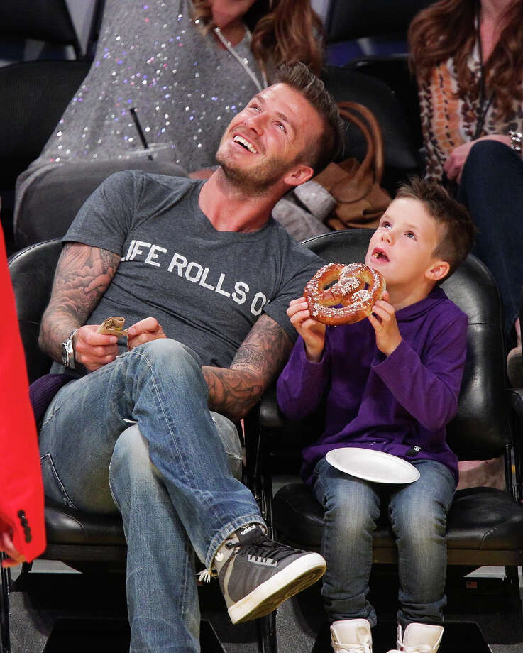 David Beckham and his son Cruz Beckham  attend a basketball game between the Dallas Mavericks and the Los Angeles Lakers at Staples Center on April 15, 2012 in Los Angeles, California. Photo: Noel Vasquez, Getty Images / 2012 Noel Vasquez