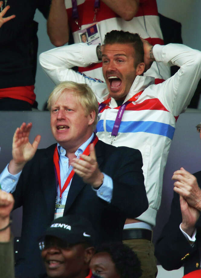 David Beckham and Mayor of London Boris Johnson celebrate as Mohamed Farah of Great Britain wins gold in the Men's 5000m Final on Day 15 of the London 2012 Olympic Games at Olympic Stadium on August 11, 2012 in London. Photo: Alexander Hassenstein, Getty Images / 2012 Getty Images