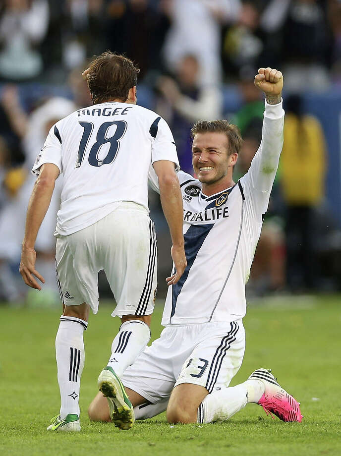 David Beckham #23 and Mike Magee #18 of Los Angeles Galaxy celebrate in the second half against the Houston Dynamo in the 2012 MLS Cup at The Home Depot Center on December 1, 2012 in Carson, California. Photo: Jeff Gross, Getty Images / 2012 Getty Images