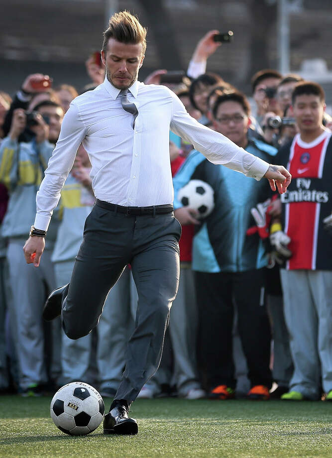 David Beckham attends a grassroots and junior football promotional with students at No.2 High school on March 20, 2013 in Beijing, China. Photo: ChinaFotoPress, ChinaFotoPress Via Getty Images / 2013 ChinaFotoPress