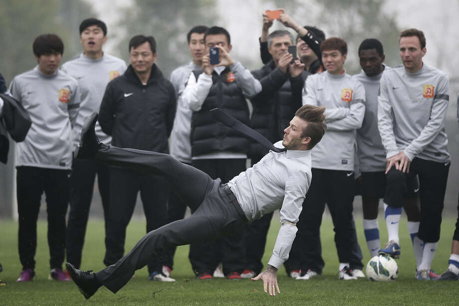 David Beckham falls during his visit to Wuhan Zall Football club on March 23, 2013 in Wuhan, Hubei Province of China. Photo: ChinaFotoPress, ChinaFotoPress Via Getty Images / 2013 ChinaFotoPress