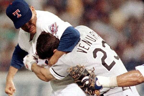 This classic photo shows Nolan Ryan's famous fight with Robin Ventura.