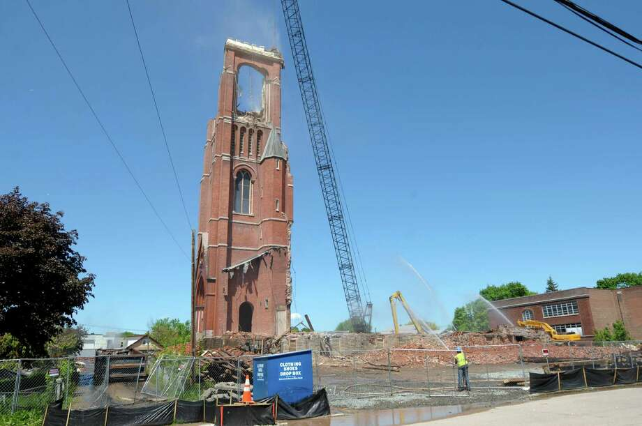 Demolition of the bell tower continues at the former St. Patrick's Church began on Thursday, May 16, 2013 in Watervliet, NY.    (Paul Buckowski / Times Union) Photo: Paul Buckowski