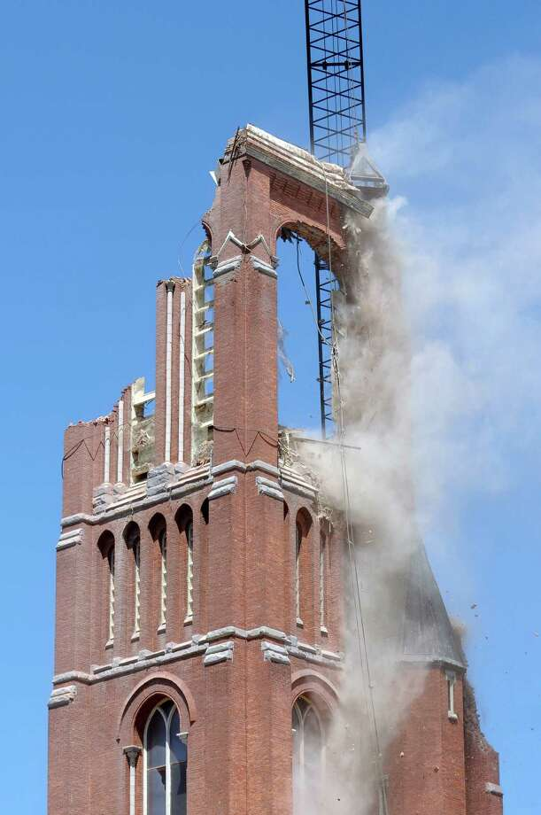 A clamshell bucket on a large crane, causes a section to crumble as the demolition of the bell tower at the former St. Patrick's Church began on Thursday, May 16, 2013 in Watervliet, NY.    (Paul Buckowski / Times Union) Photo: Paul Buckowski