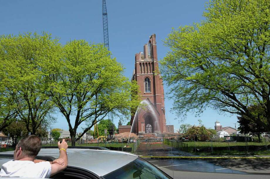 The tower is dismantled as the demolition continues of the bell tower at the former St. Patrick's Church began on Thursday, May 16, 2013 in Watervliet, NY.    (Paul Buckowski / Times Union) Photo: Paul Buckowski