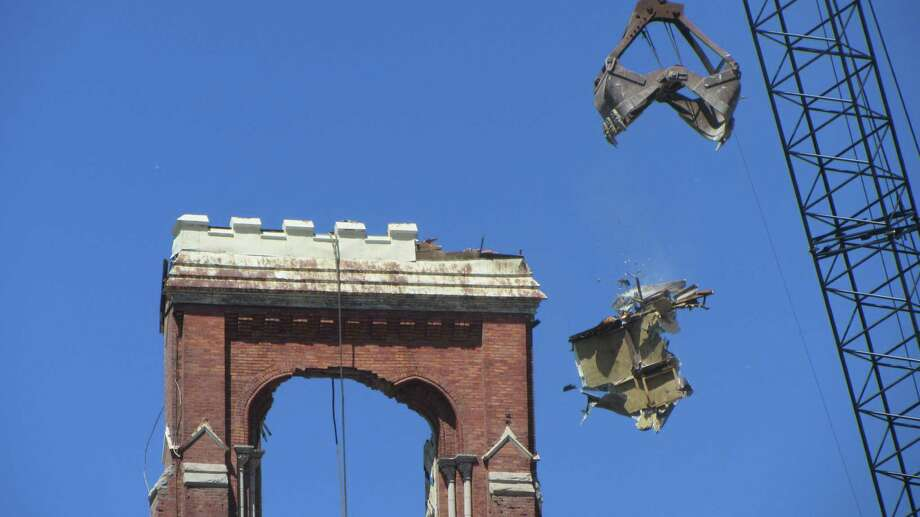 A crane removes part of the top of St. Patrick's Church in Watervliet on Thursday, May 16, 2013. (Bob Gardinier / Times Union)