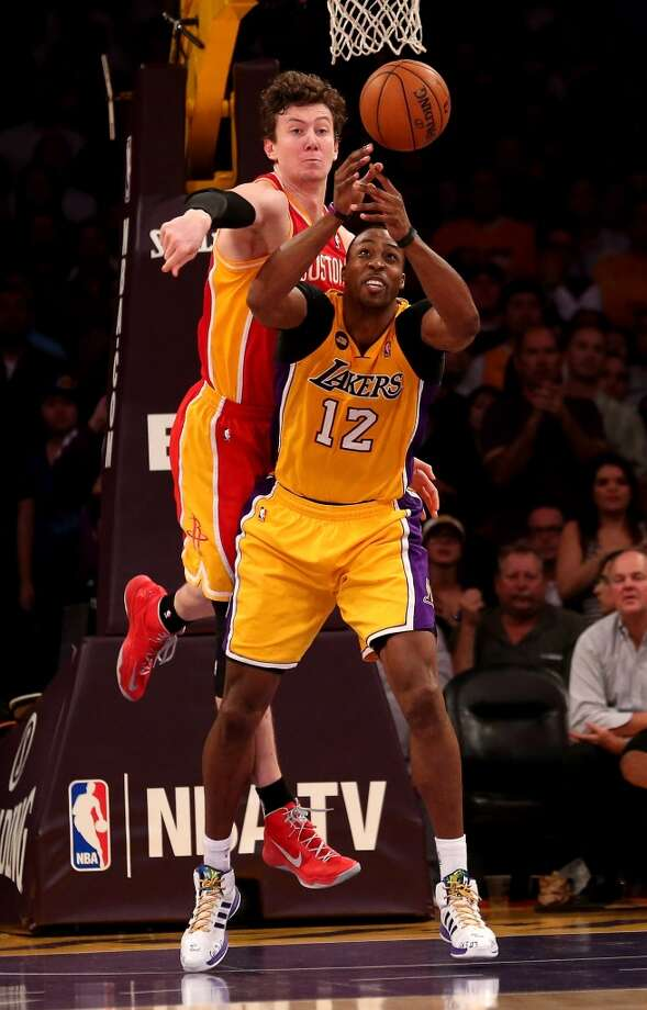 Tale of the tapeOmer AsikHeight: 7 feet Weight: 255 pounds Age: 26 Draft: 2nd round (36th overall) in 2008 by Portland.  Dwight Howard Height: 6-11 Weight: 265 pounds Age: 27 Draft: First round (No. 1 overall) in 2004 by Orlando.