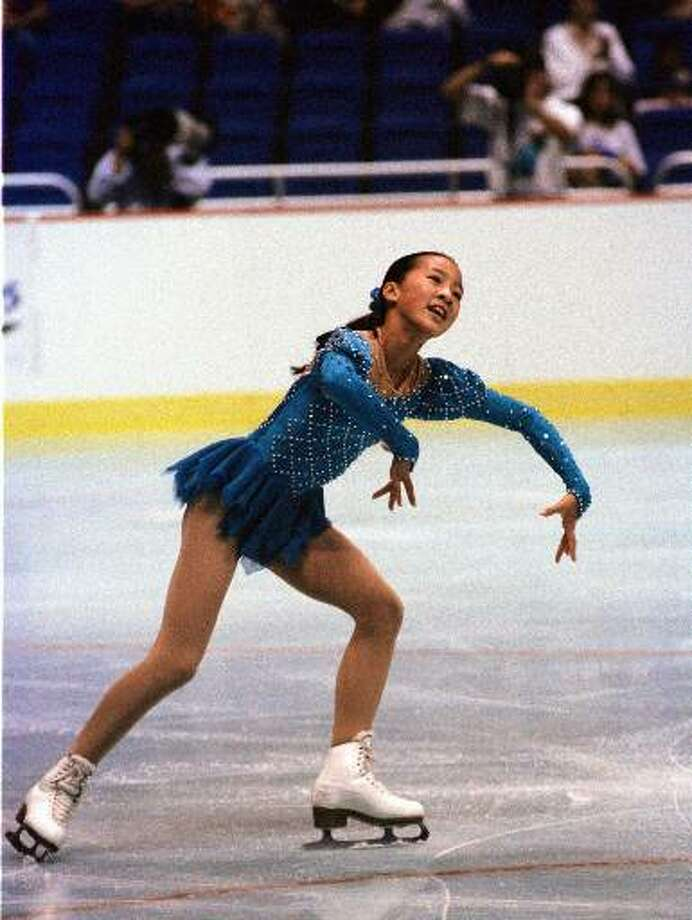 Olympic skater Michelle Kwan skates in the Alamodome during the Olympic Festival, July 24, 1993. Her performance captivated 25,691 patrons at the Alamodome, and they gave her a standing ovation as she left the ice. Several fans threw roses and other flowers onto the ice as she glided for a victory lap after claiming the gold medal.