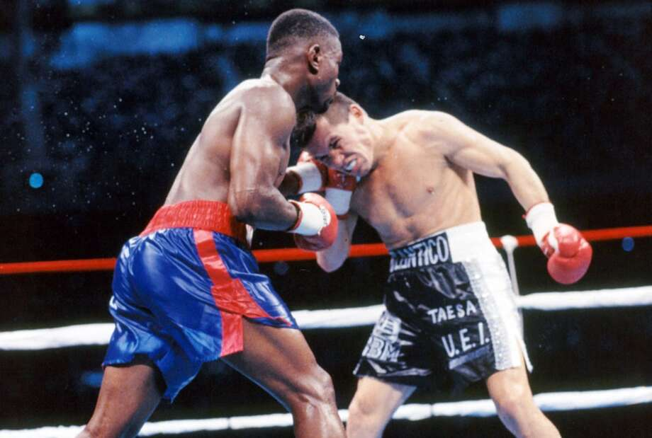 Pernell Whitaker lands a right punch against Julio Cesar Chavez during the fight at the Alamodome, on Sept. 10, 1993.
