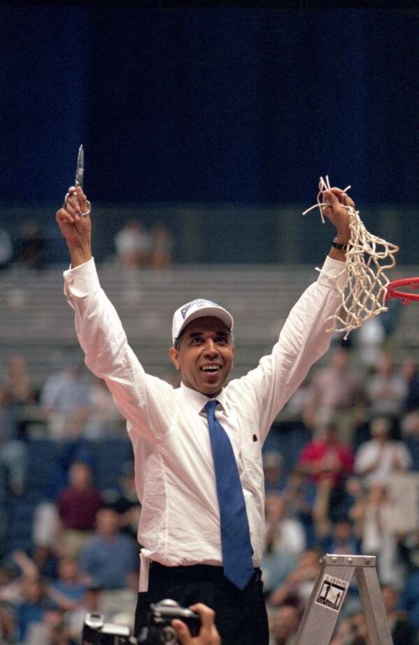 Kentucky head coach Tubby Smith celebrates after winning the 1998 NCAA men's basketball championship game against Utah on March 30, 1998. It would be the first of three Final Fours the Alamodome would host.