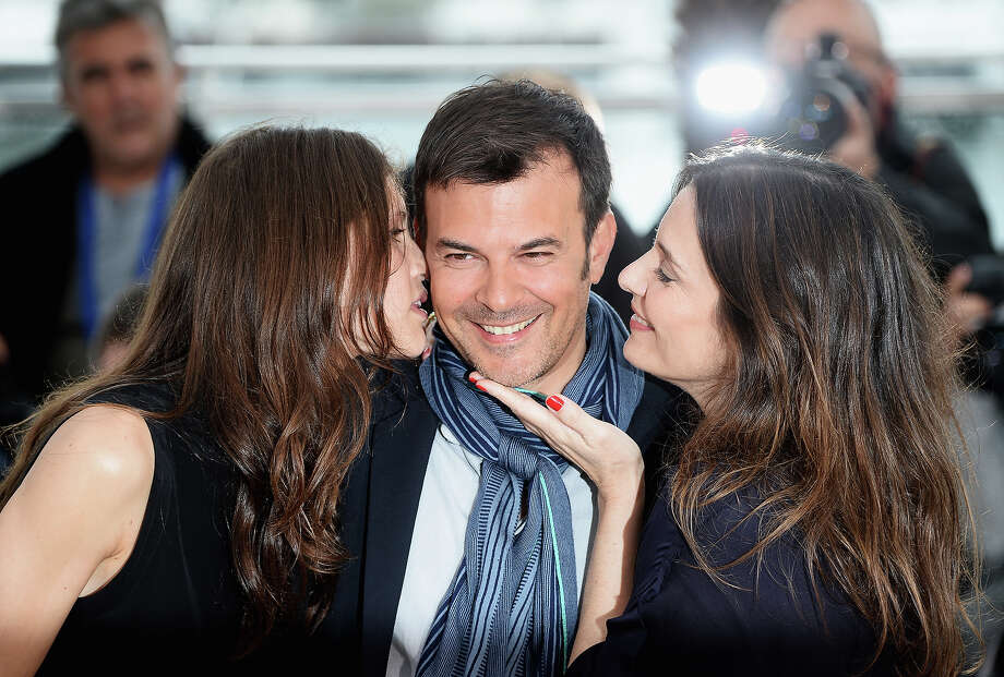 (L-R) Actress Marine Vacth, director Francois Ozon and actress Geraldine Pailhas attend the photocall for 'Jeune & Jolie' (Young & Beautiful) during the 66th Annual Cannes Film Festival at Palais des Festivals on May 16, 2013 in Cannes, France. Photo: Venturelli, WireImage / 2013 Venturelli
