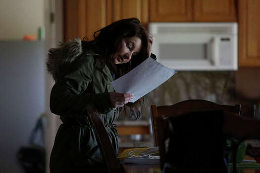 Myah Bilton-Smith looks for her discharge documents, which she needs to 