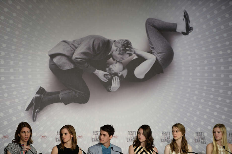 "Director Sofia Coppola (L) talks on May 16, 2013 during a press conference with (from 2ndL) British actress Emma Watson and US actors Israel Broussard, Katie Chang, Taissa Farmiga and Claire Julien for her film ""The Bling Ring"" presented in the Un Certain Regard section at the 66th edition of the Cannes Film Festival in Cannes. Cannes, one of the world's top film festivals, opened on May 15 and will climax on May 26 with awards selected by a jury headed this year by Hollywood legend Steven Spielberg. Photo: ANNE-CHRISTINE POUJOULAT, AFP/Getty Images / 2013 AFP"
