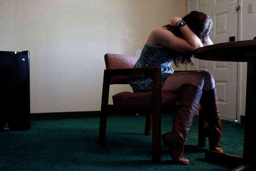 Myah Bilton-Smith in a hotel room in San Angelo, where she was stationed