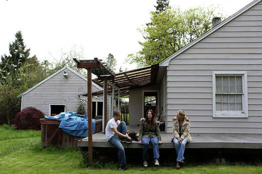 Myah Bilton-Smith relaxes with her boyfriend, Stefan Jackson, and her mother, Tina Clemans, on the porch of a relative's home in Roseburg, Ore. Photo: Lisa Krantz / San Antonio Express-News