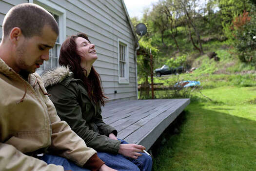 Myah Bilton-Smith relaxes with her boyfriend, Stefan Jackson, on the porch of a relative's home in Roseburg, Ore. Photo: Lisa Krantz / San Antonio Express-News