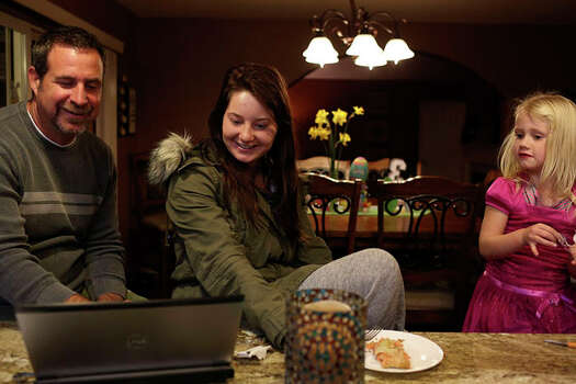 Myah Bilton-Smith looks at family photos with her father, Mark 