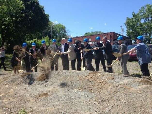 Habitat for Humanity Capital District breaks ground on its Sheridan Hollow Redevelopment Partnership in Albany, NY, on Thursday, May 16, 2013. (John Carl D'Annibale/Times Union)