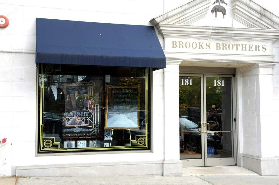 Brooks Brothers on Greenwich Avenue has a poster of the film of The Great Gatsby in their window store in Greenwich, Conn., Thursday, May 16, 2013. Photo: Helen Neafsey / Greenwich Time