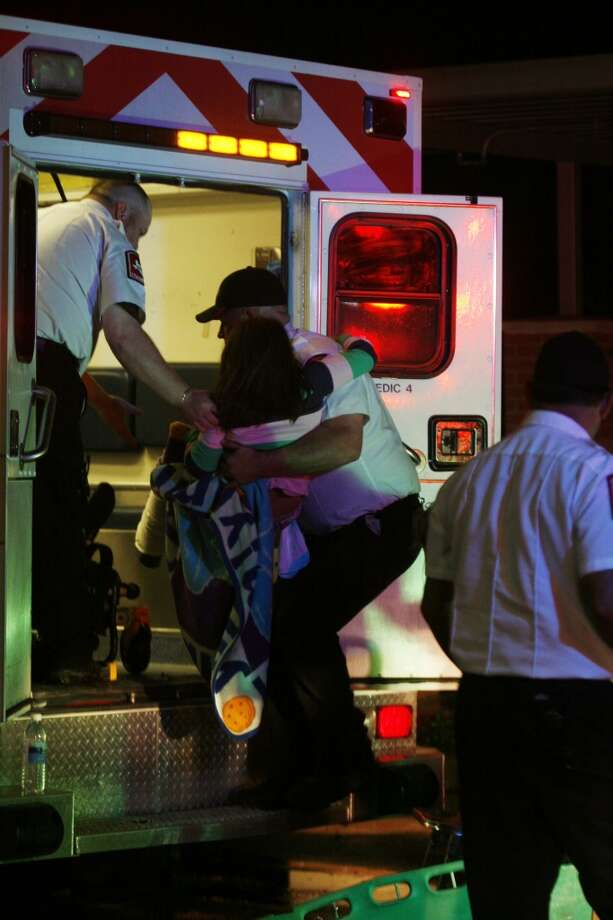 A young injured girl is put on an ambulance in Granbury, Texas, on Wednesday May 15, 2013.  A rash of tornadoes slammed into several small communities in North Texas overnight, leaving at least six people dead, dozens more injured and hundreds homeless. The violent spring storm scattered bodies, flattened homes and threw trailers onto cars. (AP Photo/Mike Fuentes)