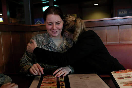 Myah Bilton-Smith gets a celebratory hug from her mother, Tina, upon her discharge from the Air Force at McChord Air Force Base in Tacoma, Wash. Photo: Lisa Krantz / San Antonio Express-News