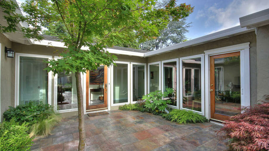 The rear yard features brick and aggregate hardscape on a lot size of 6,629 square feet.
