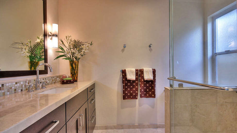 When the house was remodeled in 2008, heated floors were installed in the master bathroom and the hall.