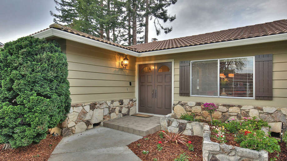 Double doors leading in to this one-story house in Los Altos.