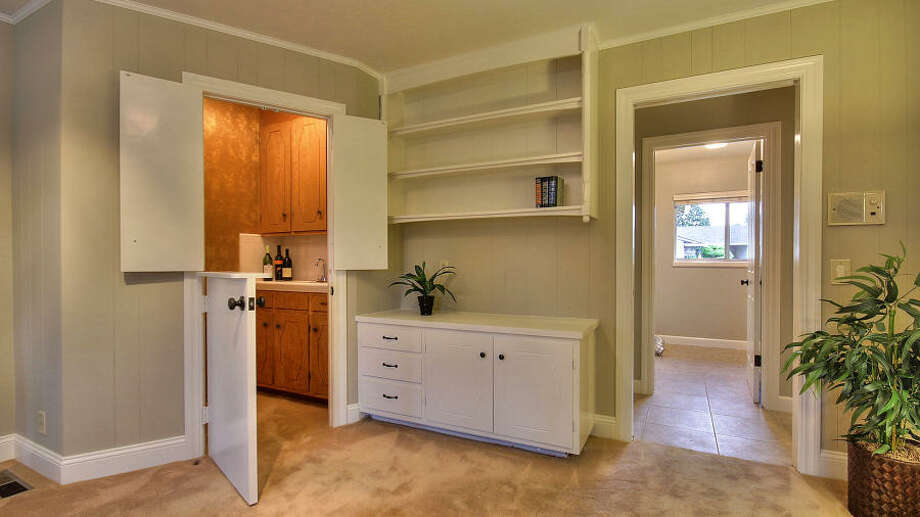 This custom built-in wet bar is reached from the living room.