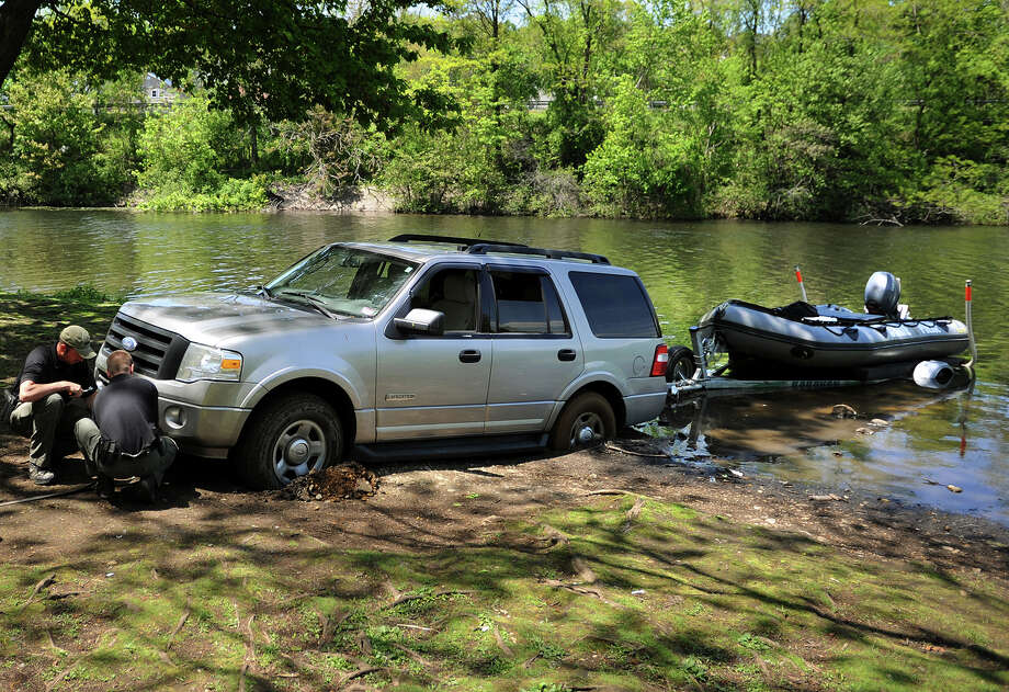 A state police SUV is stuck in the mud while attempting to trailer out a state police dive boat following a search for missing ECSU student Alyssiah Marie Wiley in Bunnell's Pond in Bridgeport, Conn. on Thursday, May 16, 2013. Photo: Brian A. Pounds / Connecticut Post