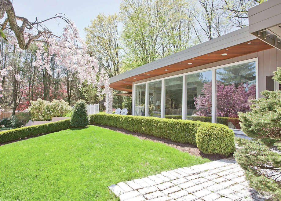 The front exterior of the house at 17 Burr Farms Road, a Post Modern-style structure built in 1951. Photo: Contributed Photo / Westport News