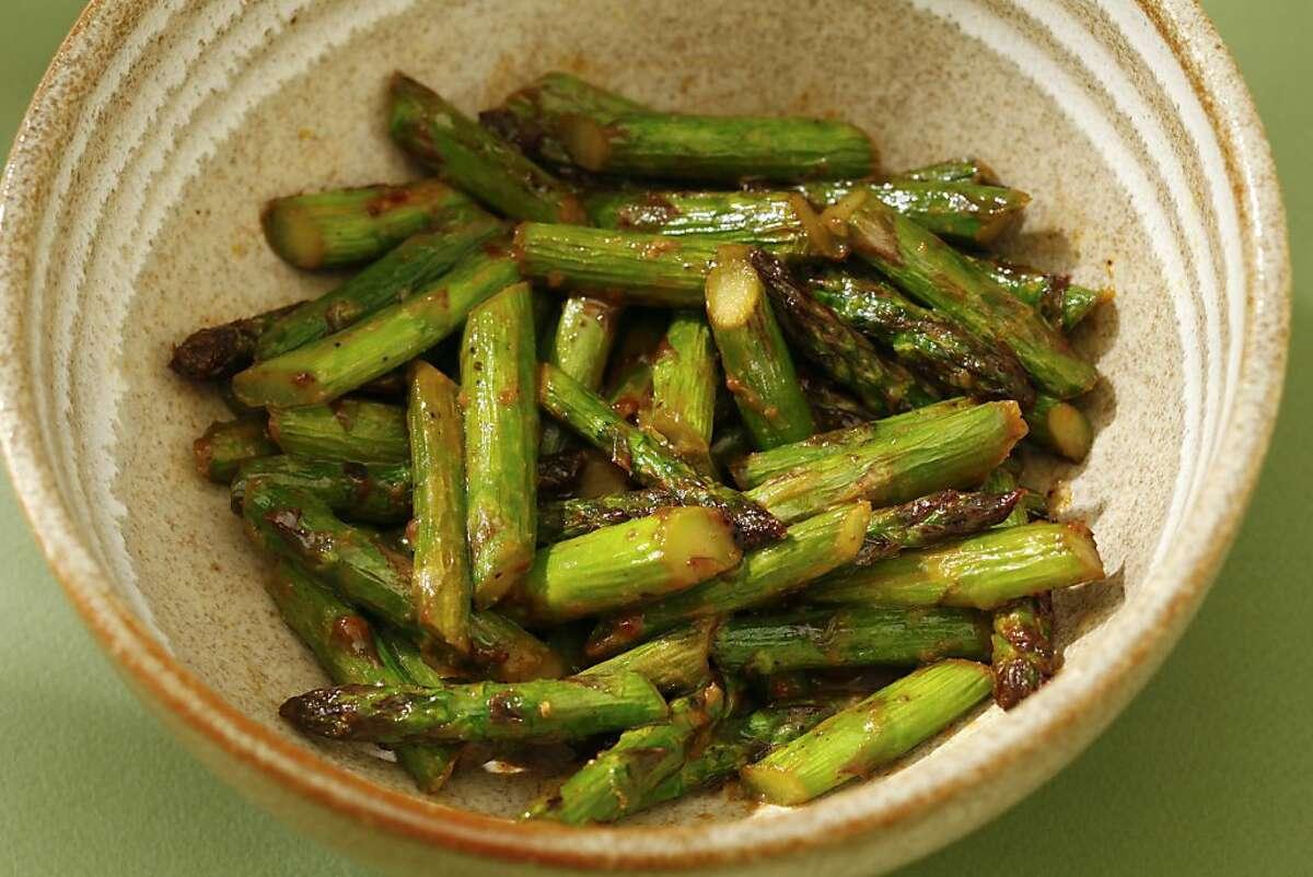 Koji-marinated asparagus with lemon zest.